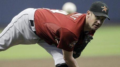 Houston Astros starting pitcher Roy Oswalt throws during