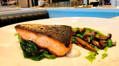 Seared Arctic char with pea greens and pea