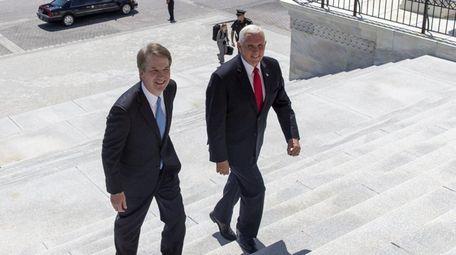 Supreme Court nominee Brett Kavanaugh, left, is escorted
