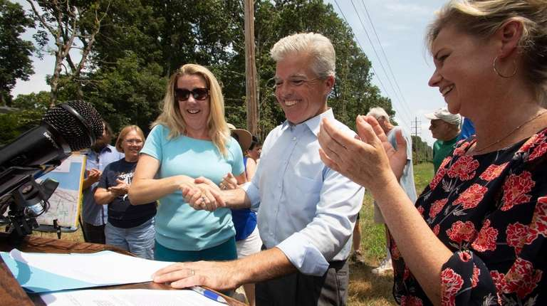 Suffolk County Executive Steve Bellone signs a bill