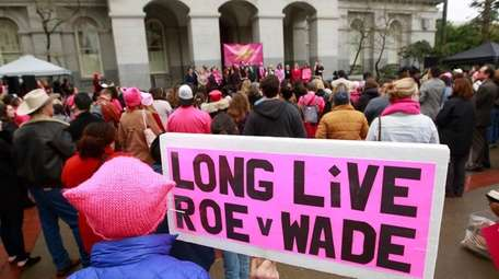 Supporters attend a rally held by Planned Parenthood,
