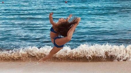 Kidsday reporter Giovanna LaGrega dancing on the beach.