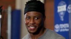 Giants running back Saquon Barkley talks to the