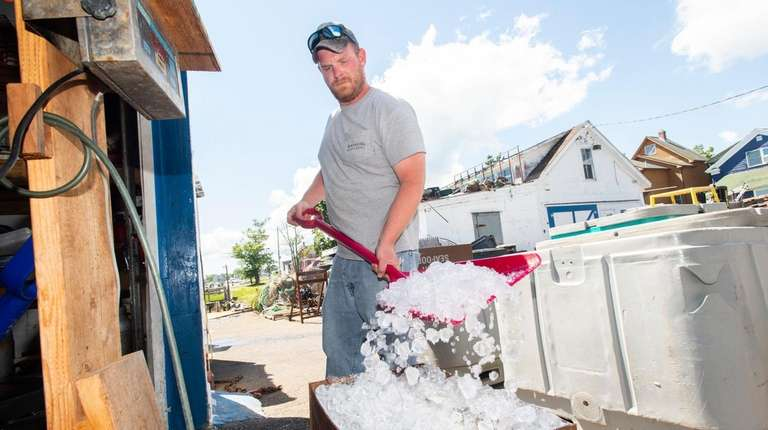 Nate Phillips packs fish from the day's take