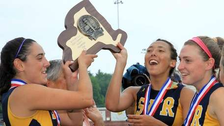 Shoreham-Wading River celebrates their victory in the Class