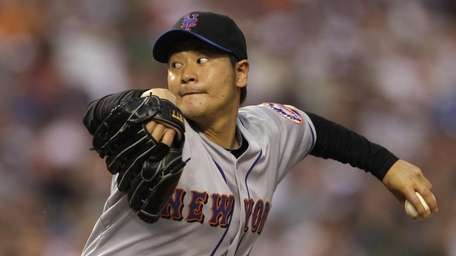 New York Mets' Hisanori Takahashi of Japan, delivers