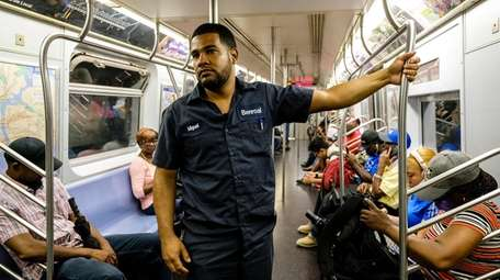 Miguel Mane prepares to exit the J train