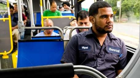 Miguel Mane rides a bus from Jamaica to