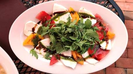 A Caprese-and-arugula salad at Ruggero's, which has opened