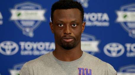 Giants corner back Eli Apple talks to the