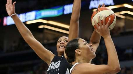 Team Candace Parker's Liz Cambage, right, shoots the