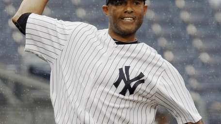 In the rain, Yankees relief pitcher Mariano Rivera