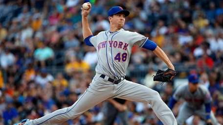 Mets starting pitcher Jacob deGrom delivers in the