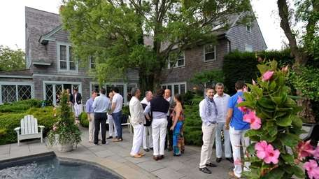 Guests gather by the pool during the Hetrick-Martin