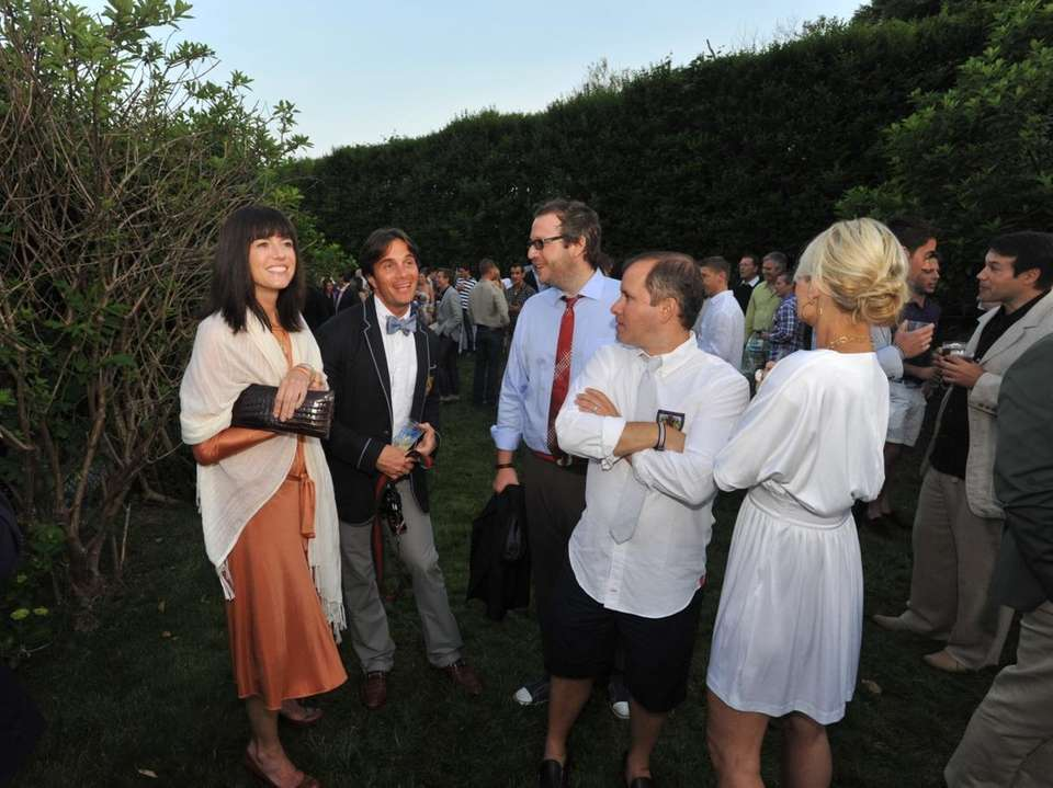 Guests gather in the garden during the Hetrick-Martin