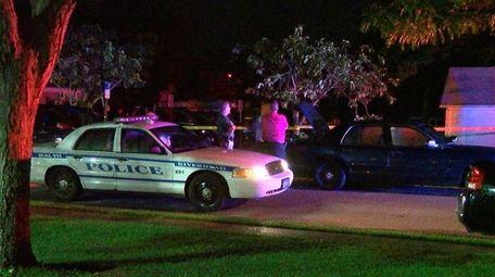 Riverhead Town police investigate the scene of a