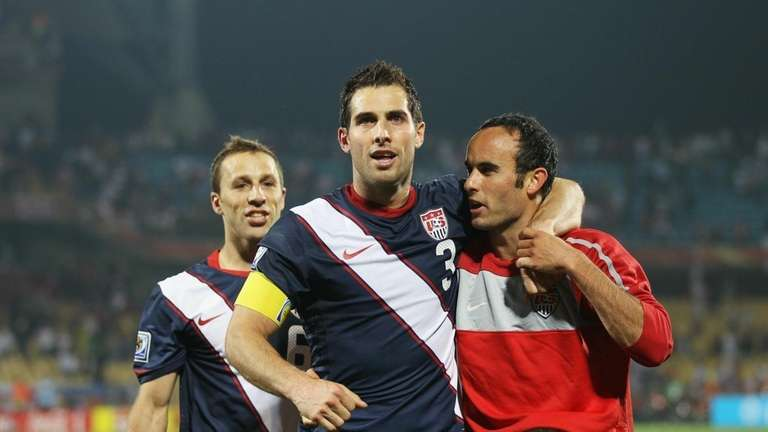 Carlos Bocanegra of the United States, center, celebrates