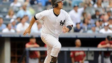 Jorge Posada watches his grand slam in the