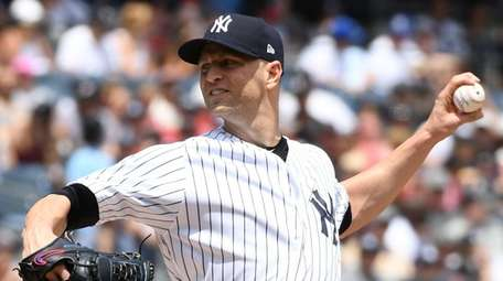 Yankees starting pitcher J.A. Happ delivers a pitch
