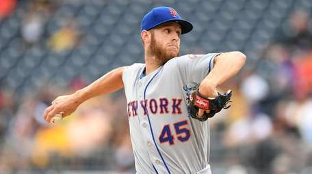 Zack Wheeler delivers during the first inning of