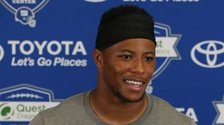 Giants running back Saquon Barkley talks to the