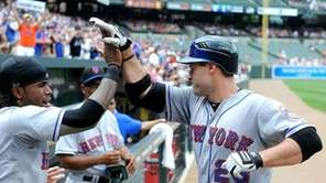 The Mets' Chris Carter celebrates with teammate Jose