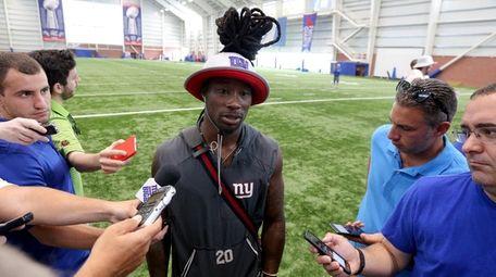 Giants corner back Janoris Jenkins talks to the