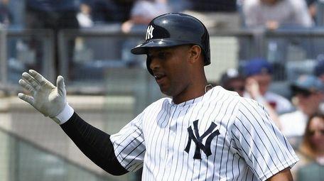 Yankees center fielder Aaron Hicks reacts after he