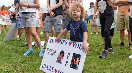 Remy Zech, 3, attends an anti-gun violence rally