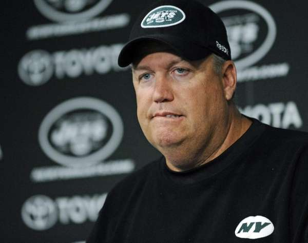Jets head coach Rex Ryan listens to a