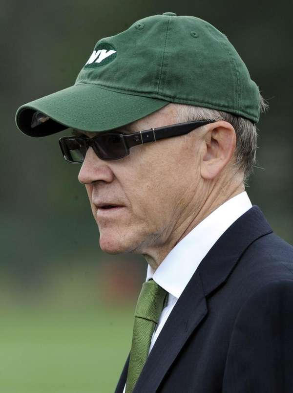 Jets owner Woody Johnson watches practice during the