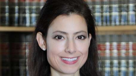 Christie R. Jacobson of Massapequa has been promoted