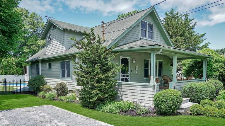 The Greenport home has three bedrooms and two