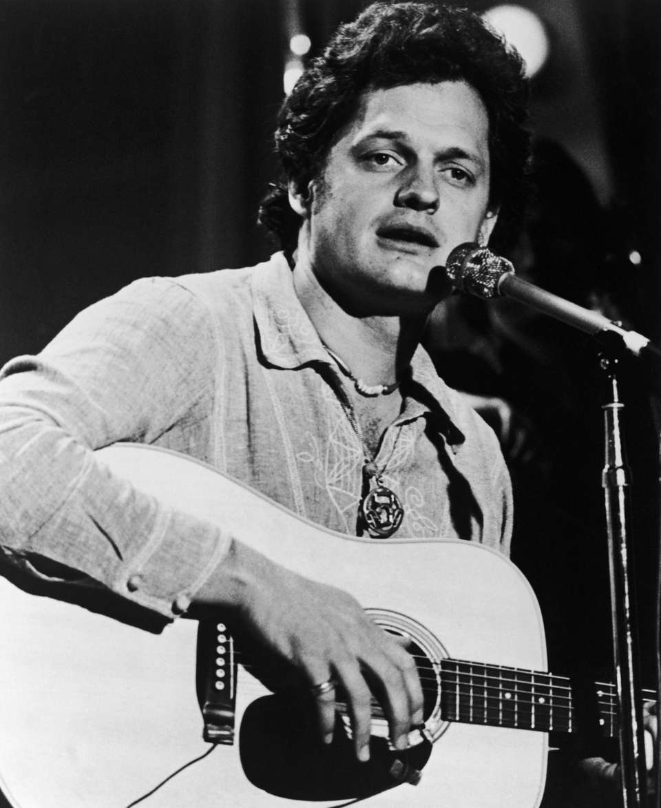 American singer-songwriter Harry Chapin (1942 - 1981) plays