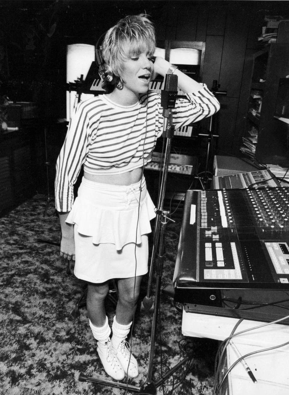 Singer Debbie Gibson, 16, practices in the studio