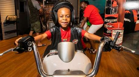 Christian Almonte, 5, of West Hempstead steers a