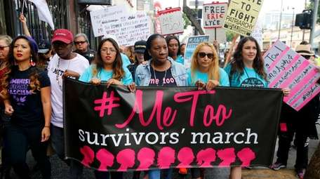 Participants march against sexual assault and harassment at