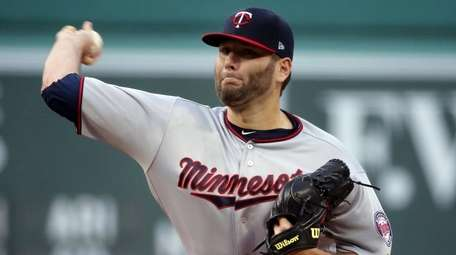 Twins starting pitcher Lance Lynn delivers to the