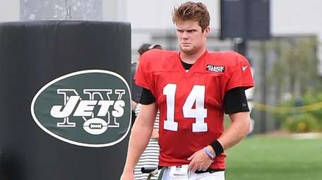 Jets quarterback Sam Darnold walks from the field