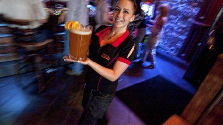 Server Ashley Brady delivers a pitcher of Blue