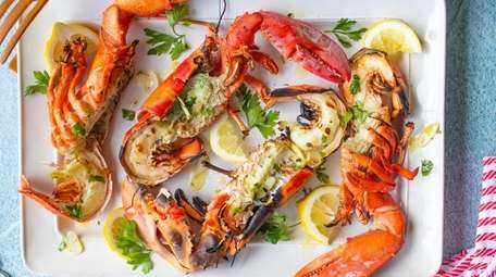 Lobsters are boiled, split, grilled until lightly charred