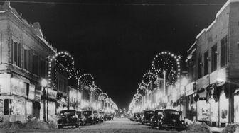 Christmas decorations illuminate a snowy Main Street of