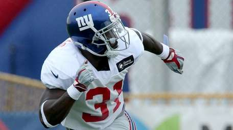 Giants safety Michael Thomas participates in a defensive