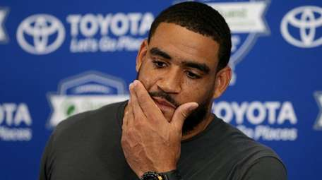 Giants defensive end Olivier Vernon talks to the
