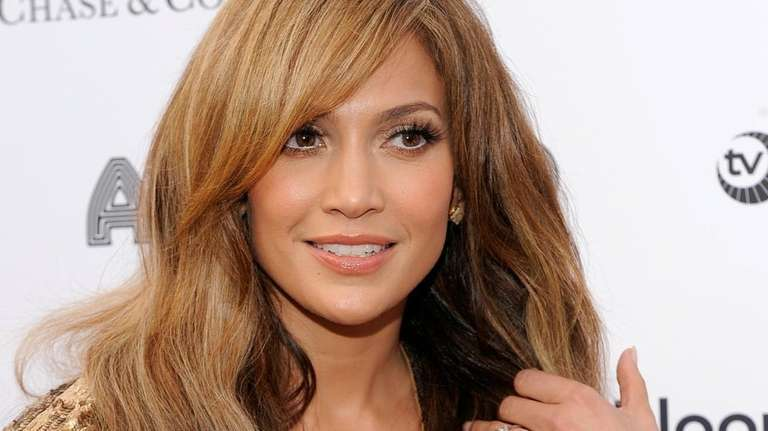 Singer\actress Jennifer Lopez poses on the red carpet