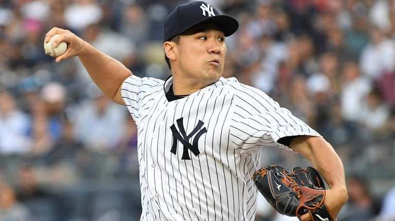 Masahiro Tanaka delivers a pitch against the Baltimore