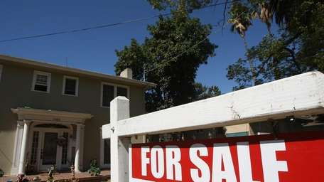 Sales of existing homes fell 27 percent in