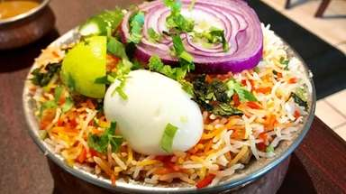 Chicken dum biryani, a world-famous Hyderabadi rice dish,