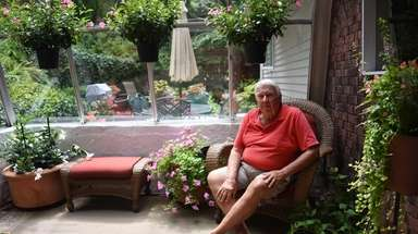 Walter Smith at his Centerport home, which he
