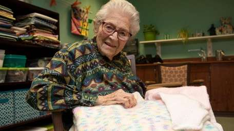Atria resident Selma Spector, 98, works on a
